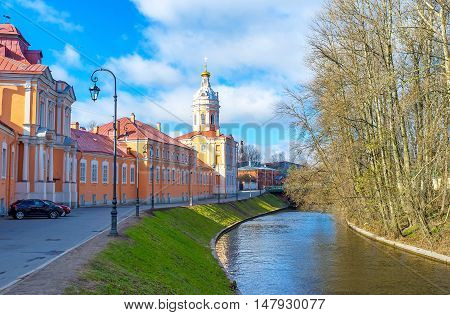 The colorful Northen (Prosfornyi) Building and the Riznica tower of Alexander Nevsky Lavra (Monastery) located at the embankment of Monastyrka river Saint Petersburg Russia.