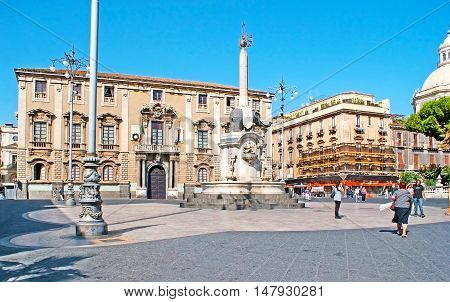 CATANIA ITALY - OCTOBER 10 2012: The architectural complex of Duomo (Cathedral) Square - The Elephant's Fountain with the scenic sculpture and the Elephant's Palase - the Town Hall on October 10 in Catania.