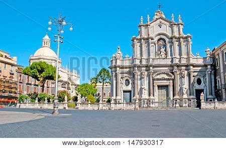 The Baroque building of St Agatha Cathedral decorated with the stone sculptures located in the central city square - Duomo Catania Sicily Italy.