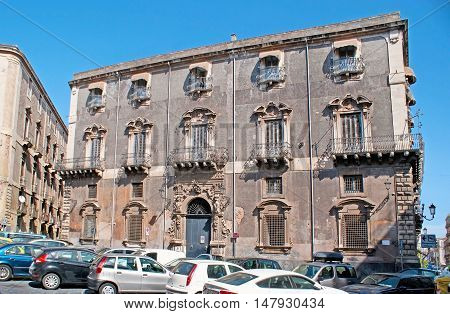 CATANIA ITALY - OCTOBER 10 2012: The old Palace-hotel in Manganelli Square surrounded by car parking on October 10 in Catania.