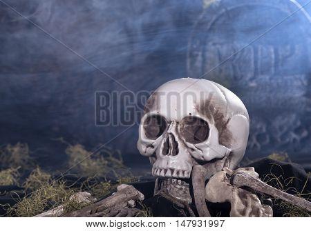 Human skull and bones in a graveyard