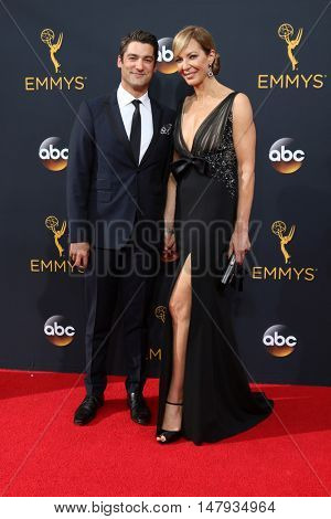 LOS ANGELES - SEP 18:  Philip Joncas, Allison Janney at the 2016 Primetime Emmy Awards - Arrivals at the Microsoft Theater on September 18, 2016 in Los Angeles, CA