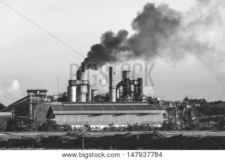 Chemical factory with smoke stack black and white tone
