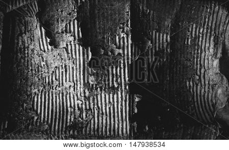 black-and-white photo of the old torn cardboard. background