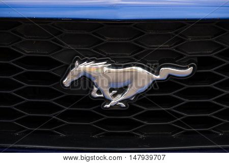 Moscow, Russia - September 10, 2016: Ford Mustang car logo on the retro car hood.