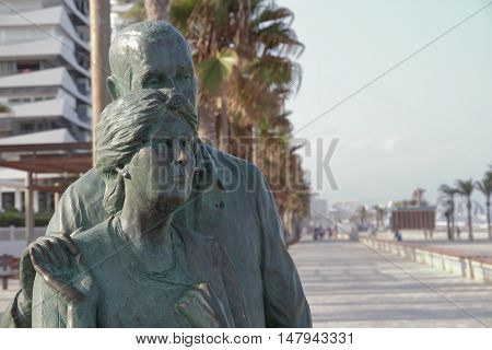 SAN JUAN ALICANTE SPAIN - AUGUST 29: foreground of a bronze statue of two elderly looking into infinity. Picture taken on August 29 2016 in San Juan beach Alicante Spain