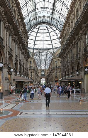 MILAN ITALY - JULY 09: Galleria Vittorio Emanuele II in Milan on JULY 09 2013. Oldest shopping mall arcade Galleria Vittorio Emanuele II in Milan Italy.