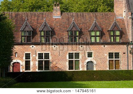 Old historic houses in Grand Beguinage in Leuven. Belgium. Flanders.