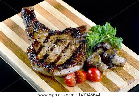 Fresh grilled pork chop ready to eat.