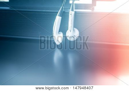 earpiece with speaker with color background .