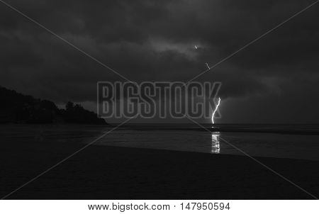 Surreal, amazing lightning penetrating the clouds and hitting the sea