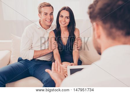 Young happy family having psychological therapy on a white background