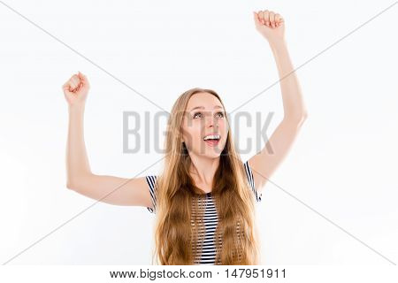 Happy Girl  With Raised Fists Celebrating Her Victory And Screaming