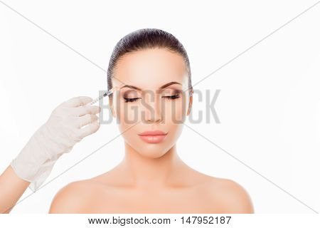 Doctor's Hands Making Cosmetic Injection In Woman's Face