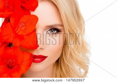Pretty Woman Hiding Half Of Her Face Behind Gladiolus Flower