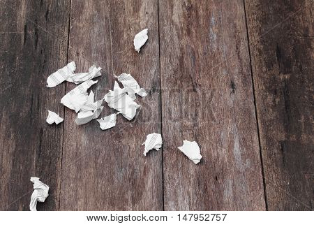 White blank sheet music ripped in Pieces and crumpled on a wooden floor background