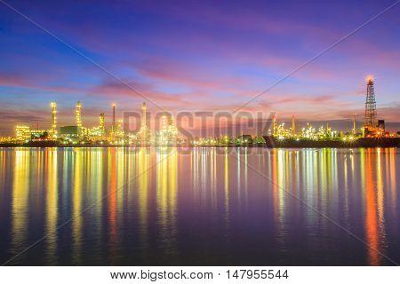 Oil refinery along the river at Dusk (Bangkok Thailand)