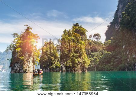 Beautiful mountains lake river sky and natural attractions in Ratchaprapha Dam at Khao Sok National Park Surat Thani Province Thailand.