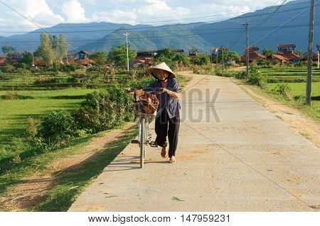 Vietnamese Old Woman Ride Bicycle
