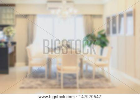 blur image of modern luxury dining room interior.
