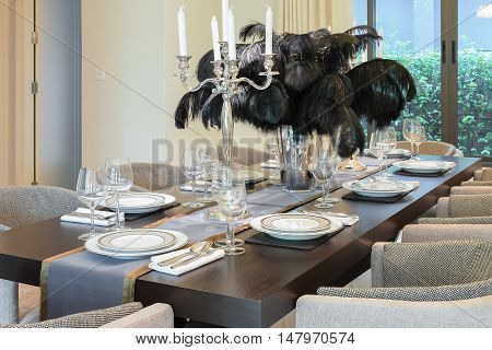 Dining Table And Chairs In Modern Home With Elegant Table Settin