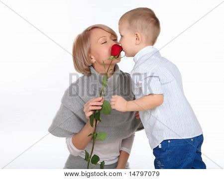 mother and son holding a red rose