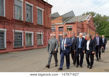 ST. PETERSBURG, RUSSIA - AUGUST 25, 2016: Vice-governor of St. Petersburg Igor Divinsky (left) in the Oktyabrsky electric railway car repair plant. The plant was founded in 1826