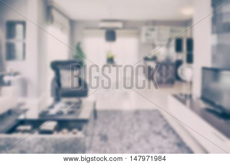 blur image of modern living room interior with dining table and pantry at home