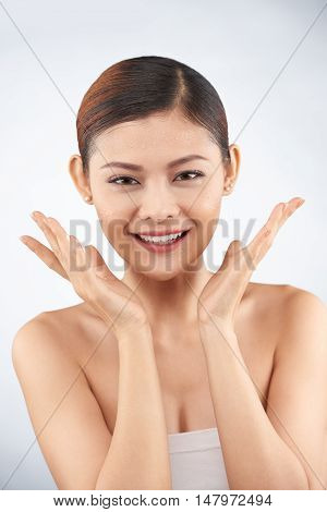Portrait of Asian attractive girl enjoying her beauty
