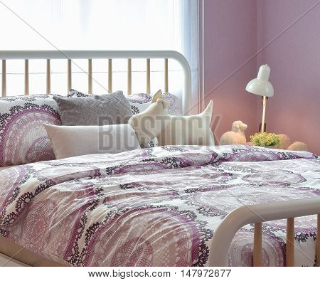 Cozy Bedroom Interior With Pillows And Reading Lamp On Bedside Table