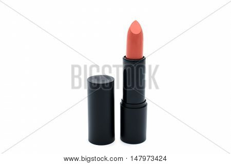 Matte brick orange lipstick isolated on white background.