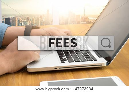 FEES SEARCH WEBSITE INTERNET SEARCHING businessman work hard and use computer