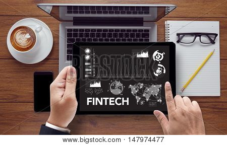 FINTECH Investment Financial Internet Technology businessman work hard and use computer