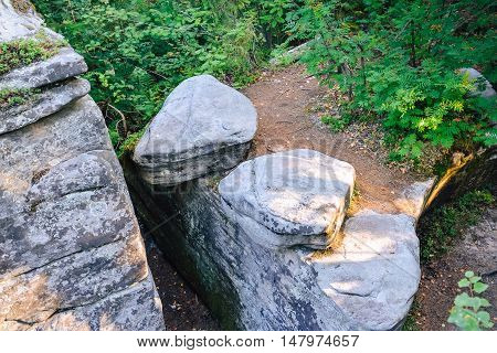 Abstract landscape of two big stones are lying near to each other over the top of the rock, Russia, Ural.