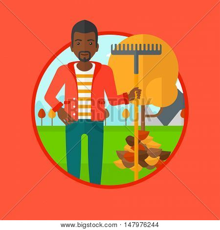 An african-american man raking autumn leaves. Man with rake standing near tree and heap of leaves. Man tidying leaves in garden. Vector flat design illustration in the circle isolated on background.
