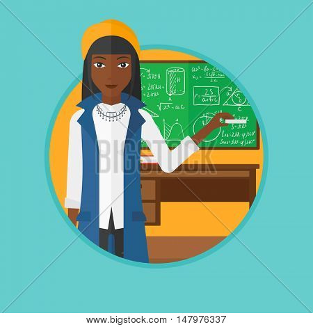 An african-american teacher standing in classroom. Teacher standing in front of the blackboard with a piece of chalk in hand. Vector flat design illustration in the circle isolated on background.