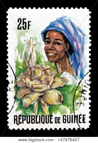 GUINEA - CIRCA 1966 : Cancelled postage stamp printed by Guinea, that shows Woman and flowers.