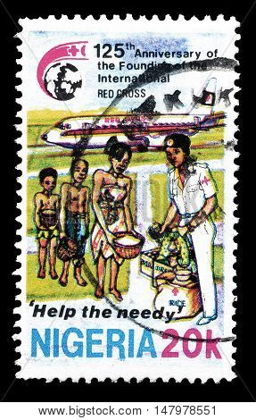 NIGERIA - CIRCA 1988 : Cancelled postage stamp printed by Nigeria, that shows Help to the needy.