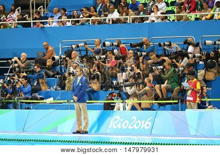 RIO DE JANEIRO, BRAZIL - AUGUST 12, 2016: Sport photographers shooting swimming competition at Olympic Aquatic Center during Rio 2016 Olympic Games