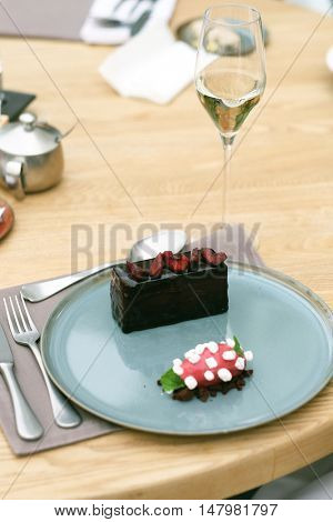 Chocolate cake with sorbet in outdoor restaurant