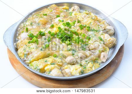 Close up oyster omelette on a hot pan