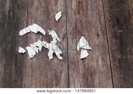 White paper sheet  rip pieces and crumpled on a wooden floor  background