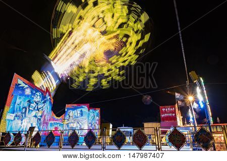 Charters Towers Australia: August 2 2016 - A colourful carnival ride spinning very fast high in the air.