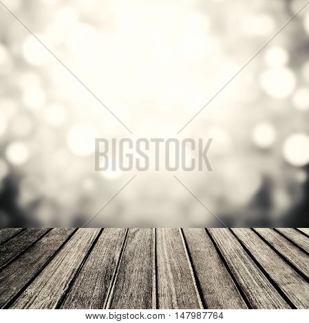 Old vintage wood panel tabletop with Festive Blurry sparkle glitter bokeh lights for your design advertising and promote products on display. Christmas Holidays