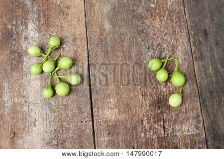 eggplant fresh organic green vegetable on a wooden background.(Solanum melongena Solanum virginianum L.)  and copy space.