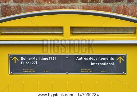 Le Mesnil sous Jumieges France - june 22 2016 : a yellow mail box