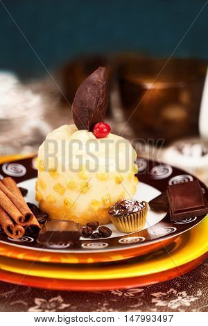 banana parfait with chocolate decoration on a plate in still life