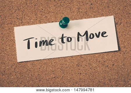 Time to Move note pin on the bulletin board