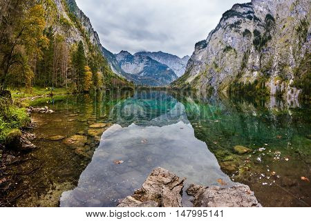 Unique lighting effects on the lake Obersee. Bavarian Alps. Berchtesgaden in Germany on the border with Austria