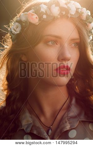 Young attractive woman with freckles portrait. Close-up photo of head of beautiful girl with fashion look. Beauty, youth, spring concept
